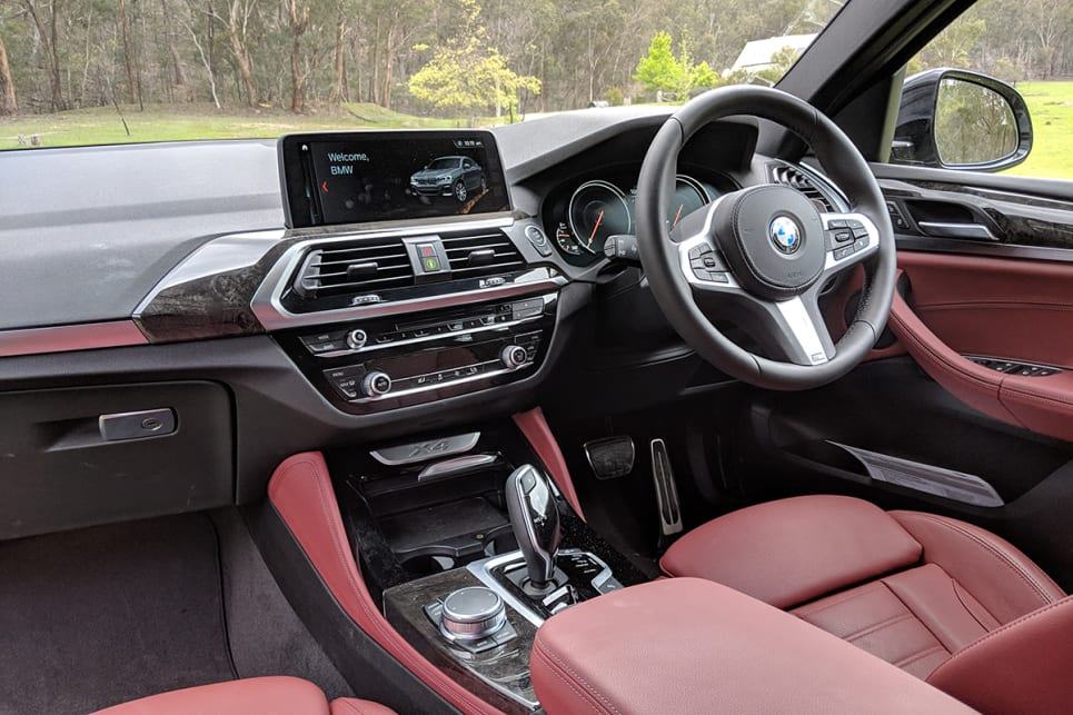 The electronically adjustable drivers' seat draped in Tacora Red Vernasca leather (a $2500 option) looks the part and offers plenty of comfort and support.