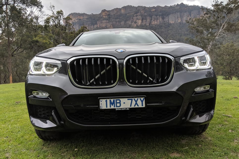 The headlights are overshadowed by the ridiculously large kidney grille with the structural supports visible behind it.