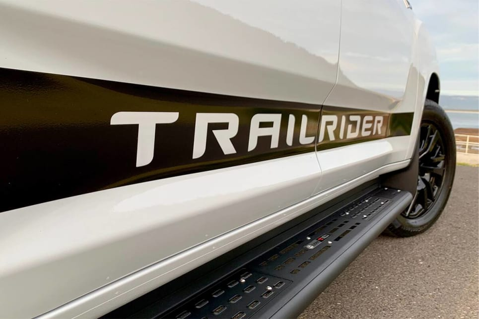 Trailrider decals line the doors on each side.
