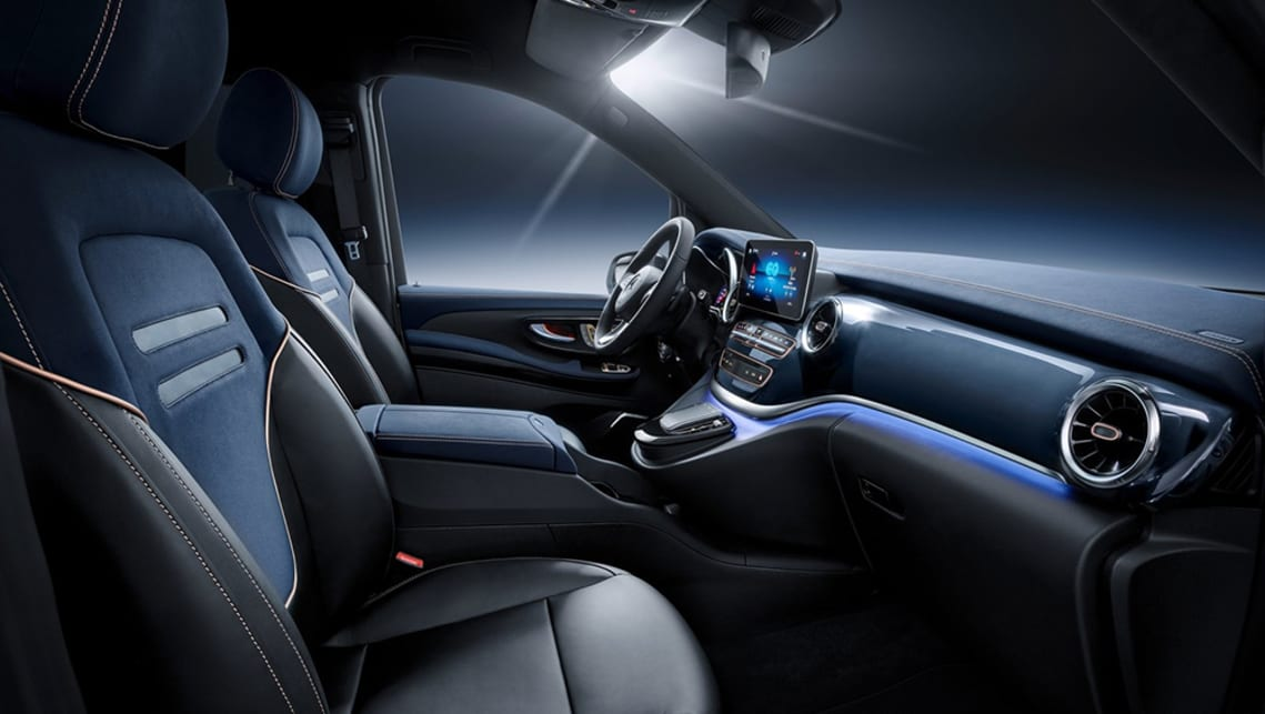 The interior sees the blue motif continue, with leather trim elements and ambient lighting tying the exterior and cabin together.