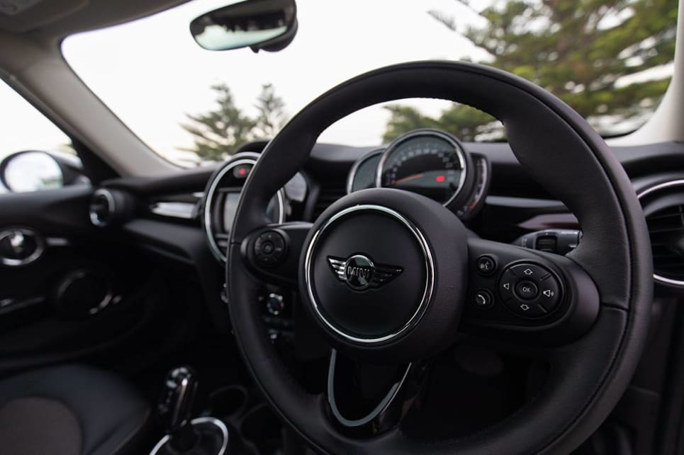 With an old-school leather-trimmed steering wheel.