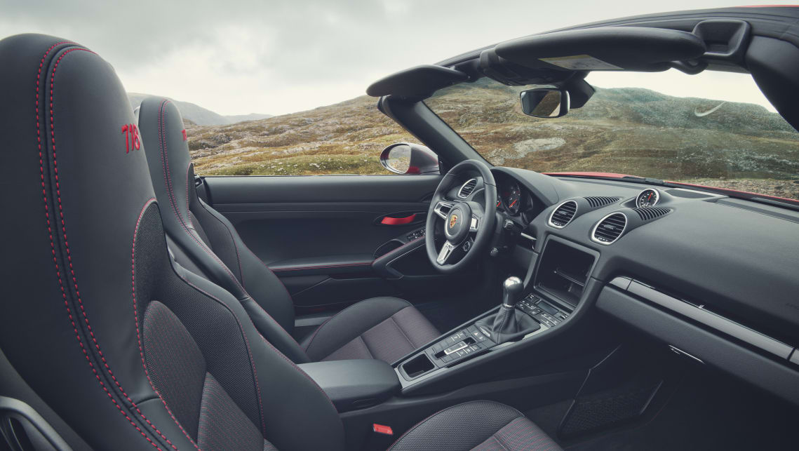 Inside, the T variants gain 718 Cayman T or 718 Boxster T logos on the instrument dials and door entry strips.