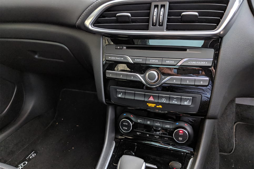 The dash layout feels dated, with numerous buttons down the centre stack.
