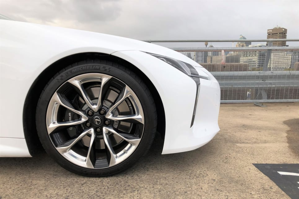 The LC500 is all bonnet and hips and giant 21-inch rims that tuck into those enormous arches.
