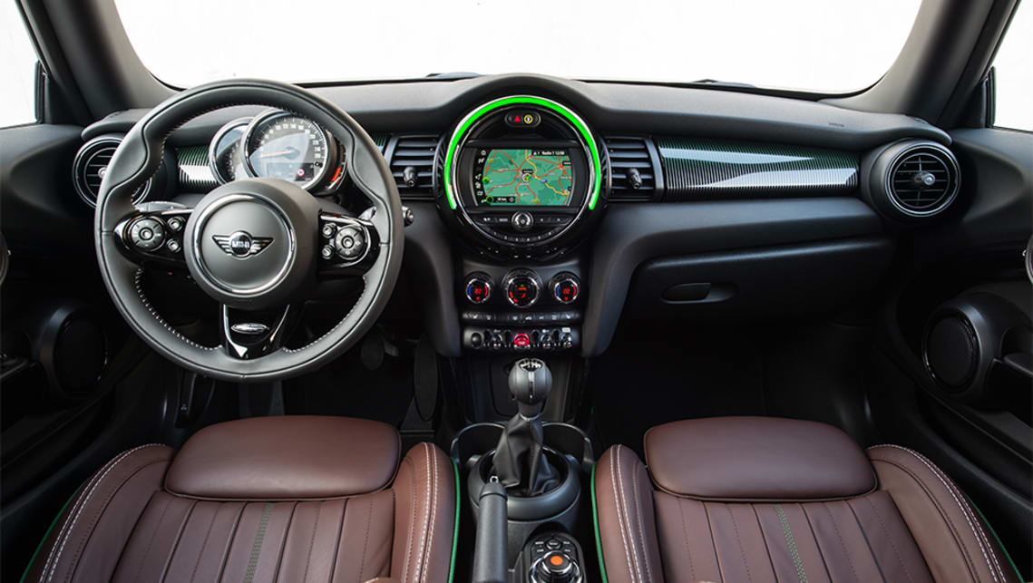 The interior of the Mini 60 Years Edition has a standard-fit Dark Cacao brown leather trim.