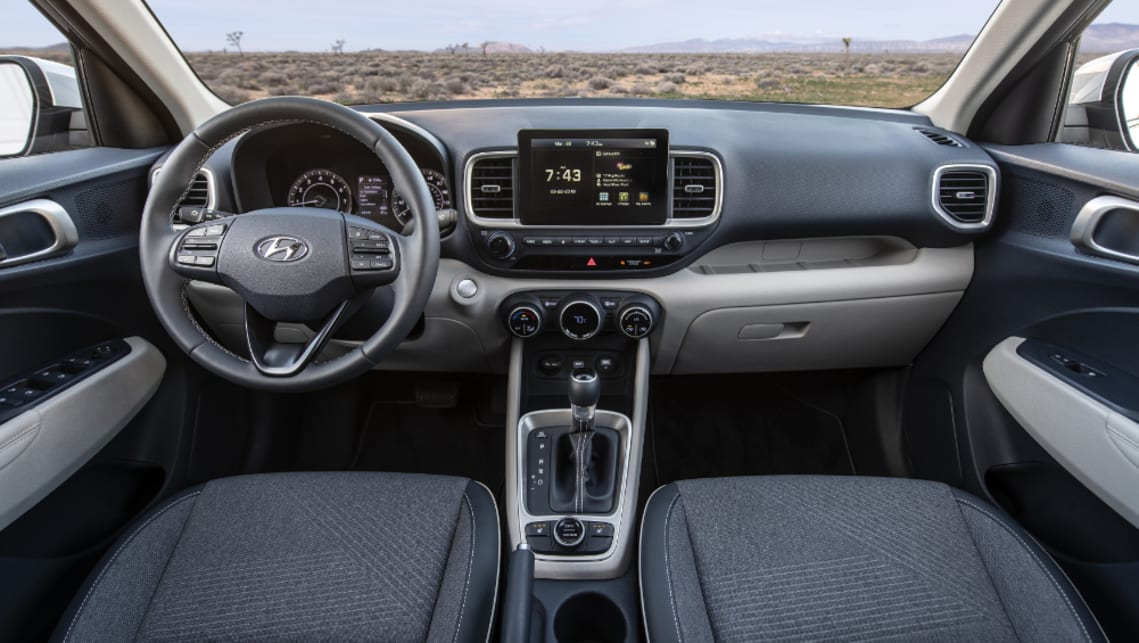 Inside is a 3.5-inch digital screen in the driver's binnacle and a leather-wrapped steering wheel.