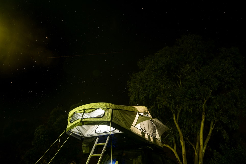 If you only need a simple shelter for sleeping and prefer to do a lot of living outside, a rooftop tent's a great option. The Feldon Shelter one of the best models on the market. Image by Brendan Batty/campertrailerreview.com.au.