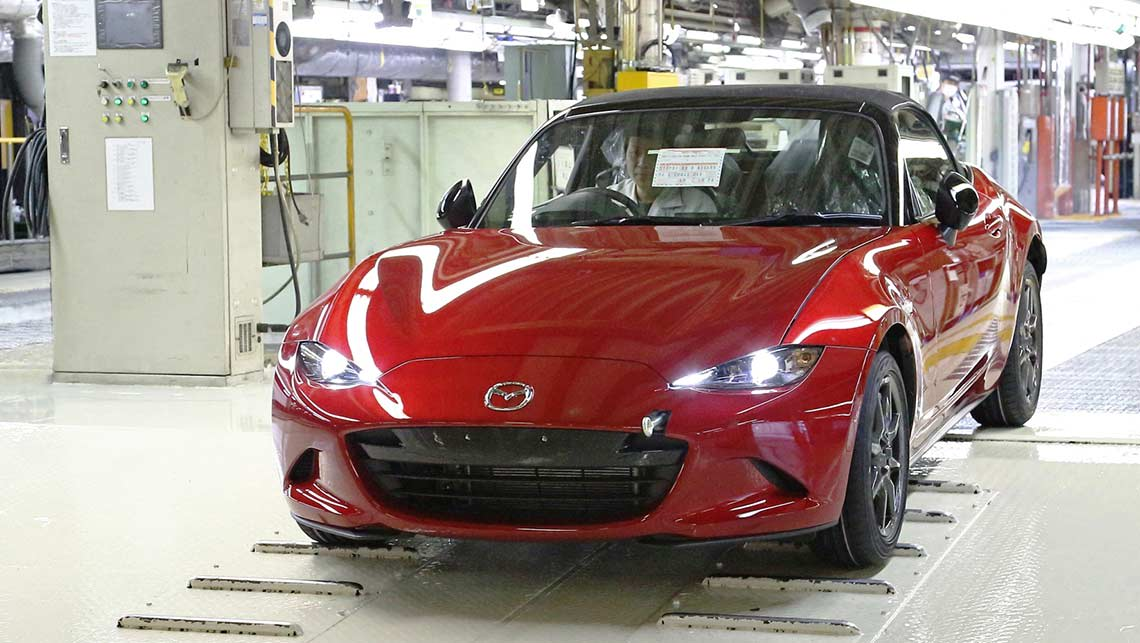 The first Australia-bound MX-5 rolls off the production line, below - first examples arrive in August.