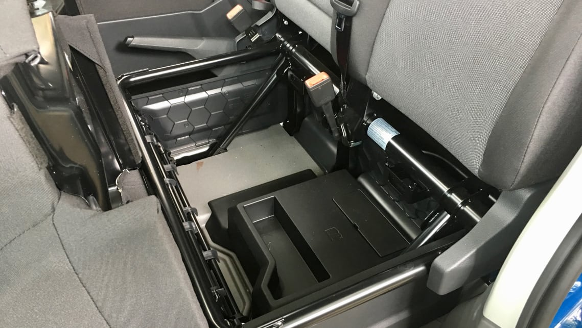 There's under-seat storage, and a fold-down table in the backrest of the middle seat.
