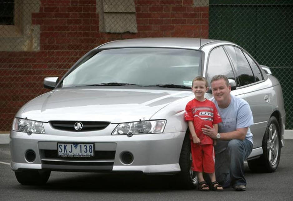 Rod Kidd and his son with the 2003 Holden Commodore VY S