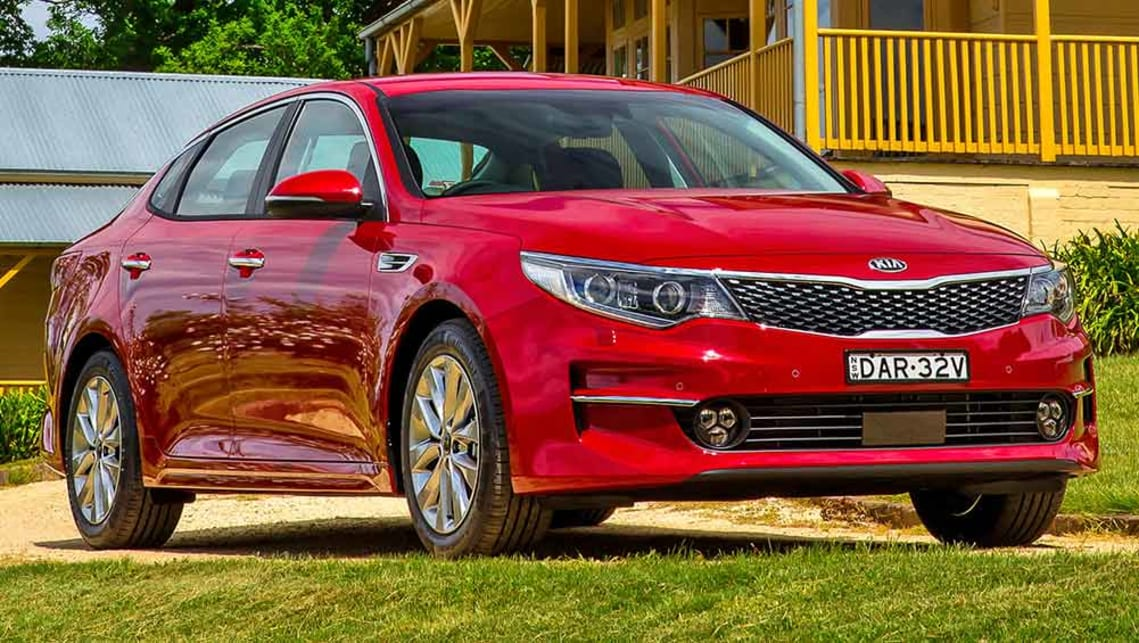 reviews vs autotrader optima the price whats s large car what kia image featured difference