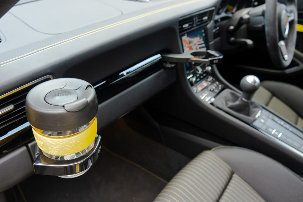 The Carrera comes with industry-best cupholders, but no bottle holders in the doors.