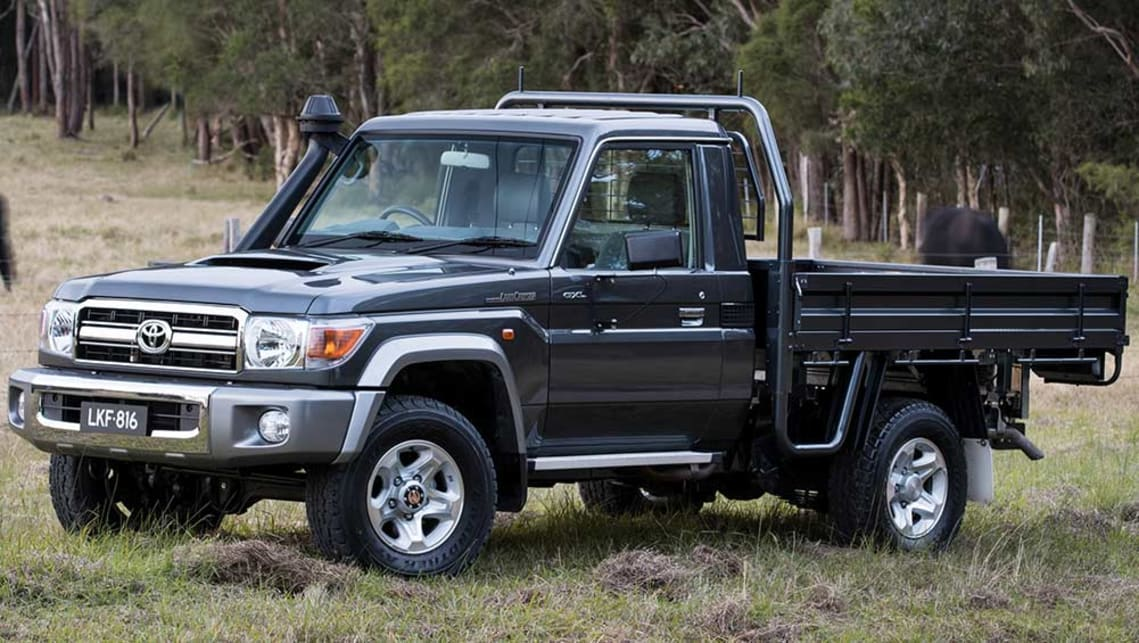 https://res.cloudinary.com/carsguide/image/upload/f_auto,fl_lossy,q_auto,t_cg_hero_large/v1/editorial/toyota-land-cruiser-70-cab-chassis-with-optional-tray-black-2016-%284%29.jpg