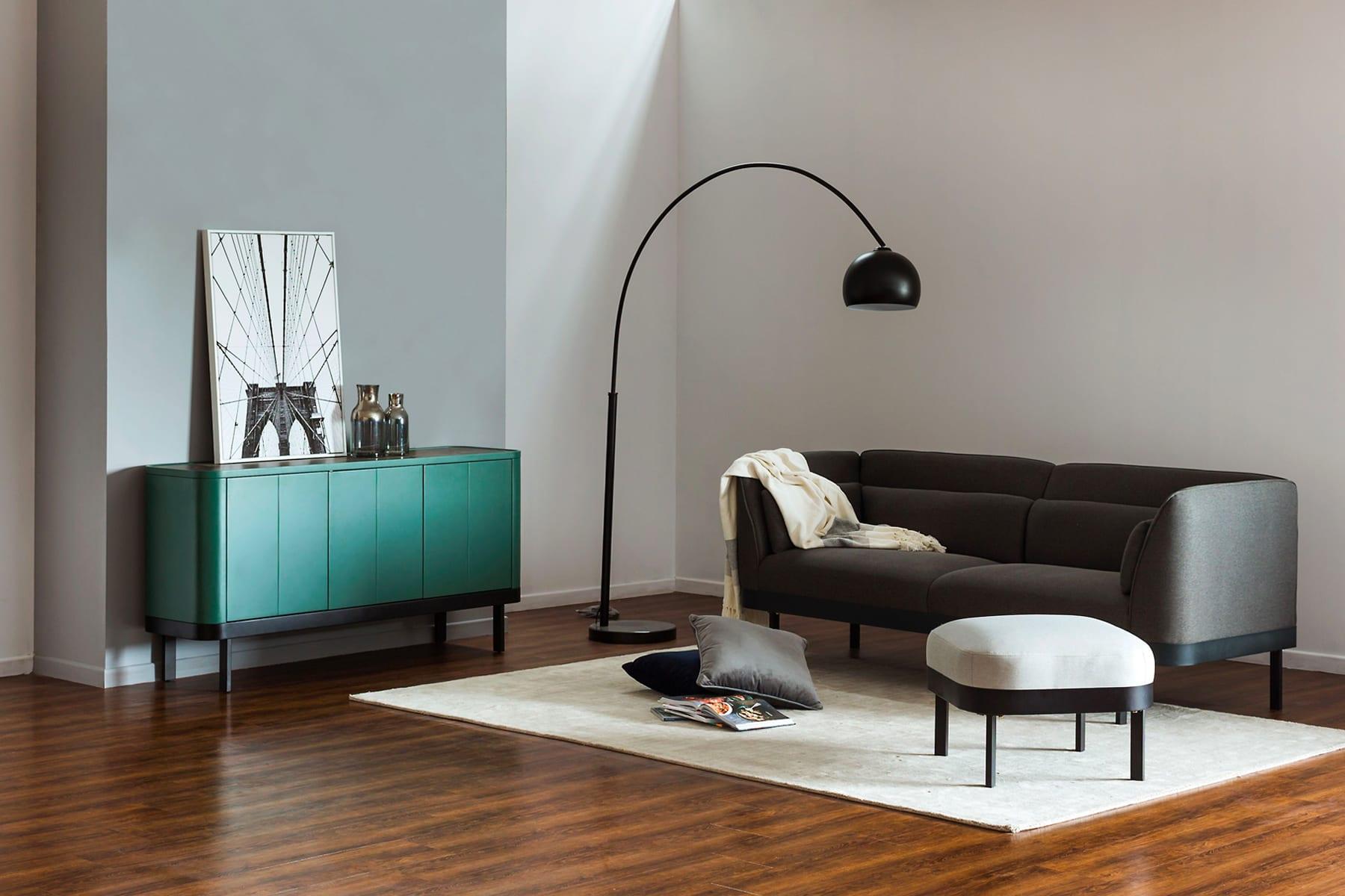 designer living room with sofa, ottoman and sideboard designed by polish designer krystian kowalski