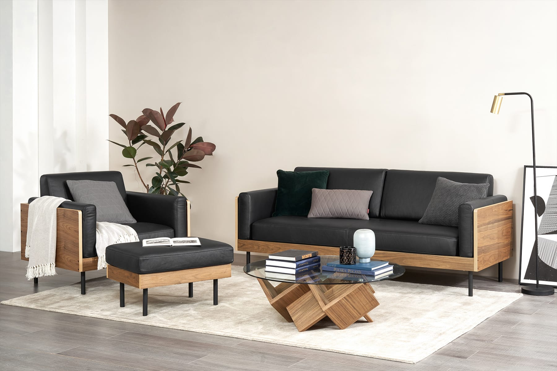 light and airy living room furniture with black leather sofa, geometric glass coffee table and floor lamp