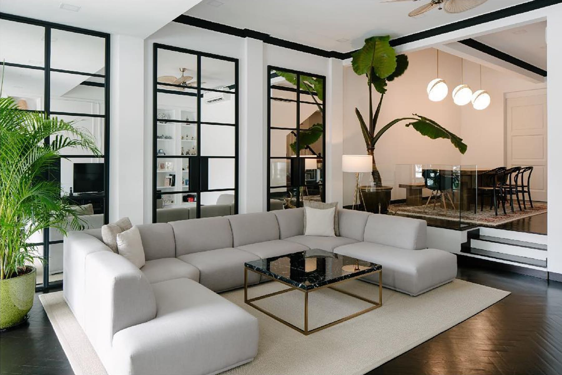 living room furniture with sectional sofa, marble coffee table, lights and plants