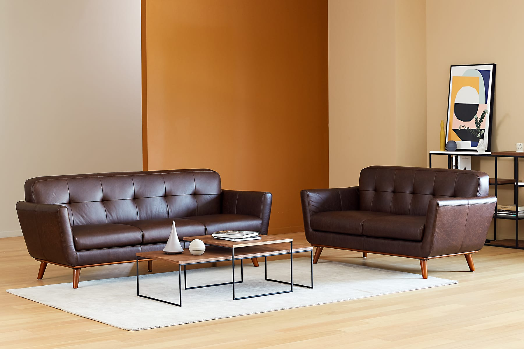 living room with brown top-grain leather sofa,  coffee table and book shelf