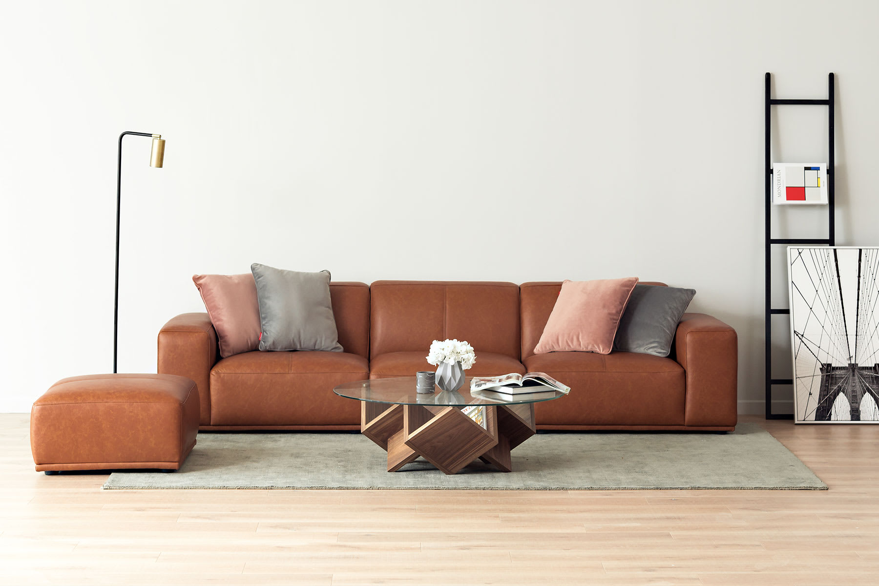 living room furniture with brown leather sofa, coffee table and rug