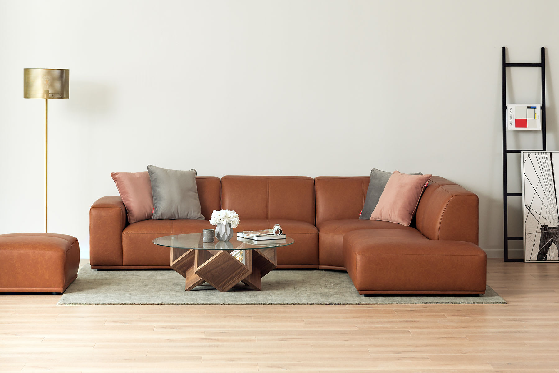 sectional chaise modular leather sofa with coffee table, rug and lamp in living room