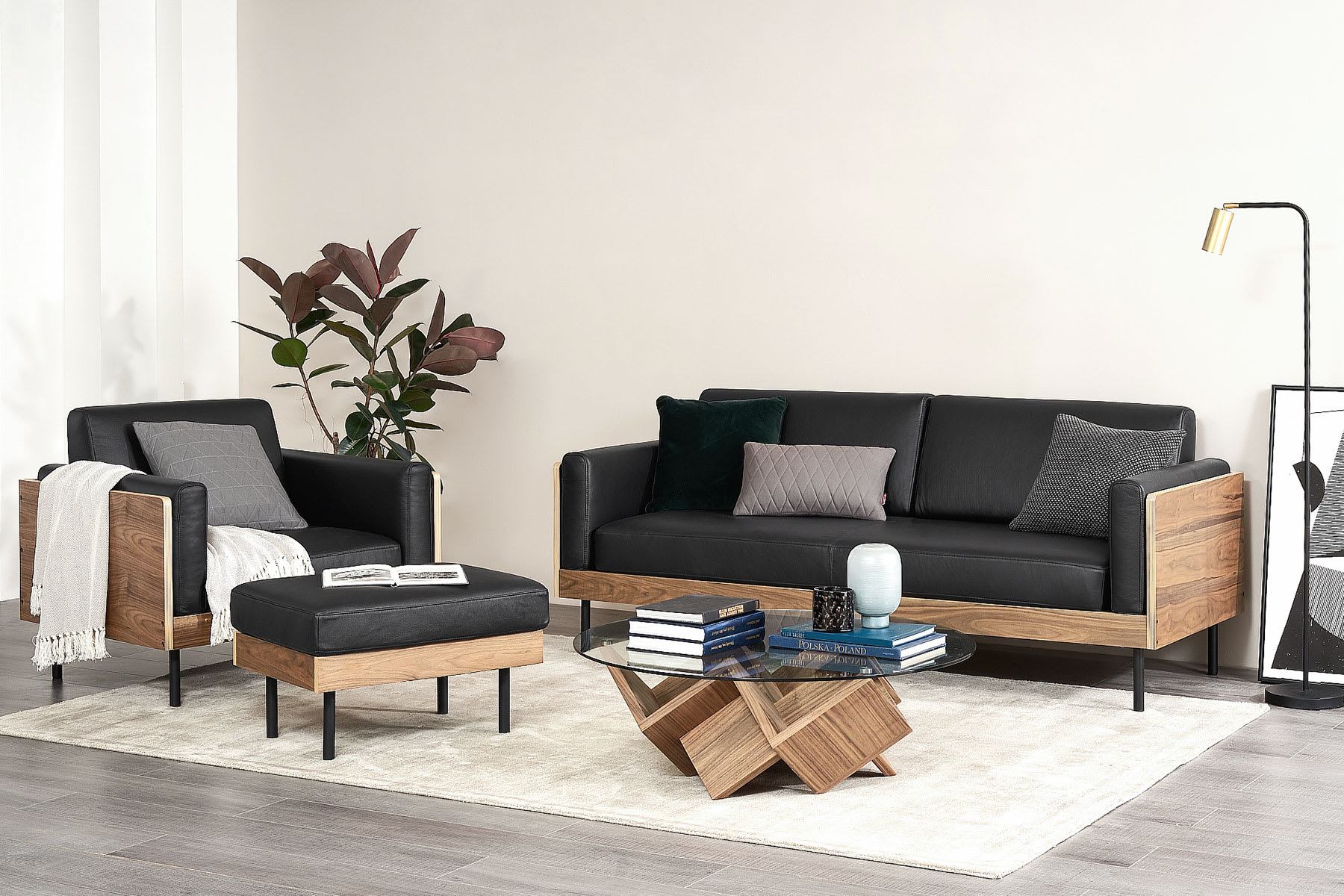black leather sofa and armchair in living room
