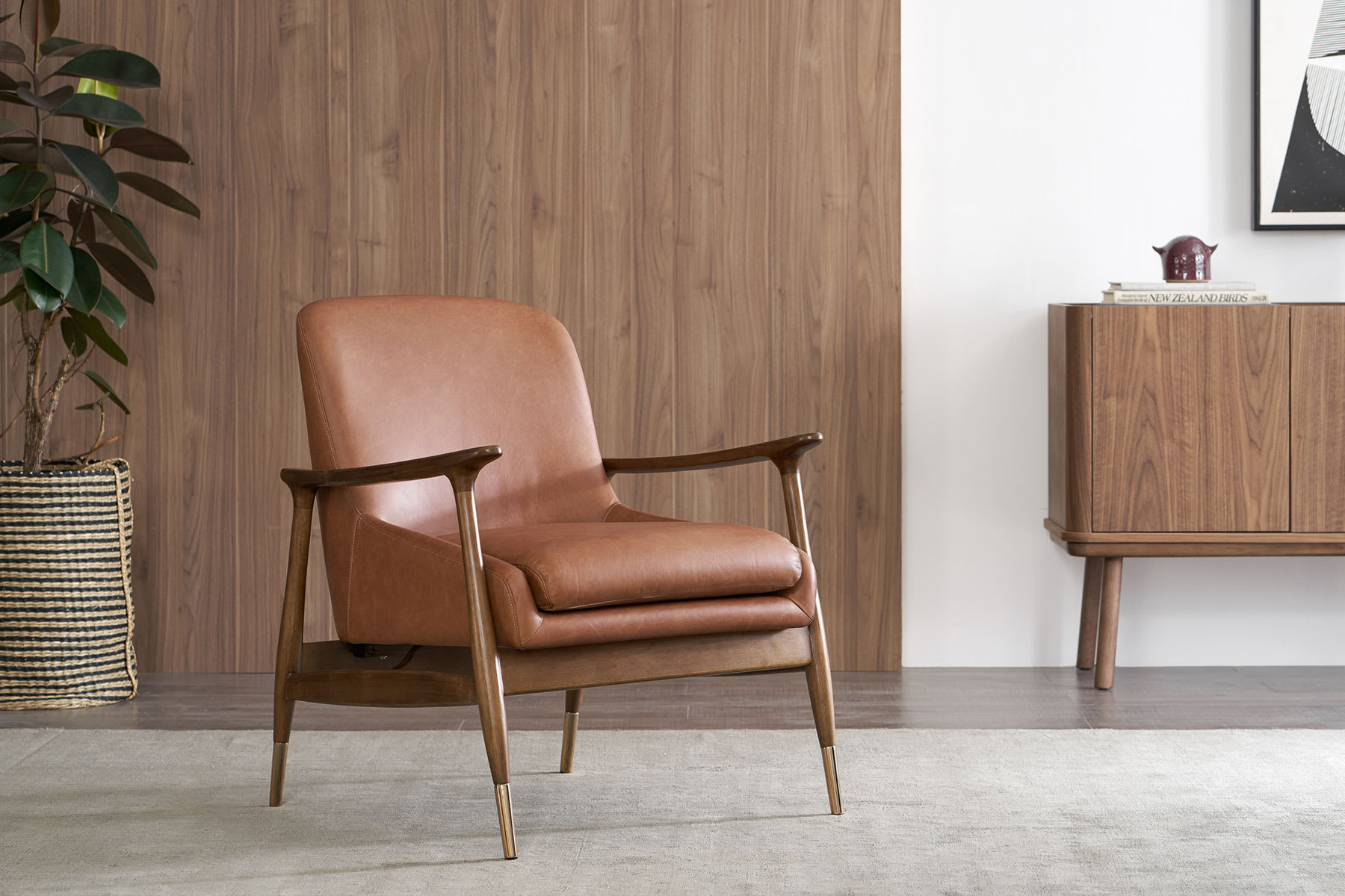 brown leather armchair in mid-mordern century style