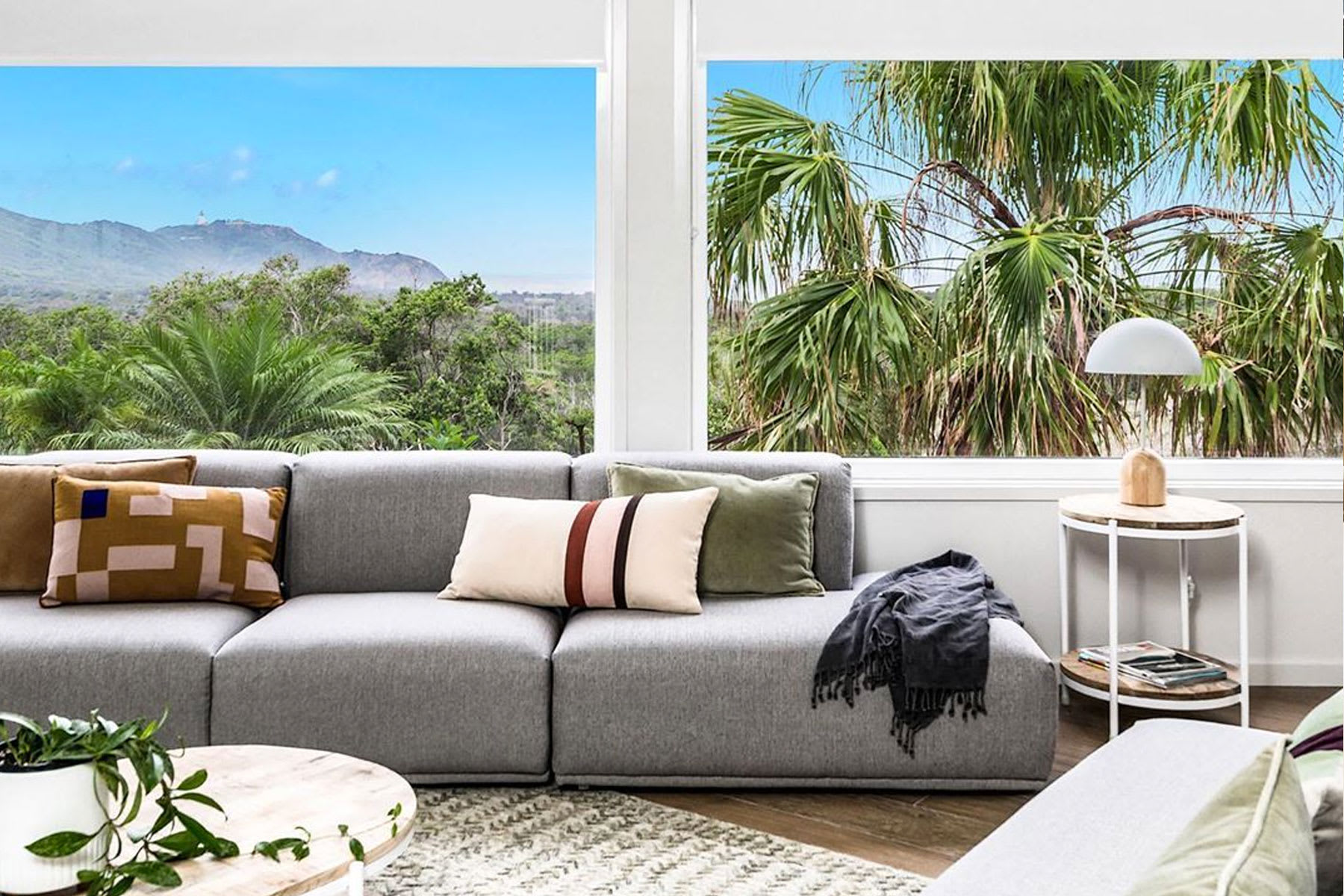 modular grey sofa in living room with a view and side table