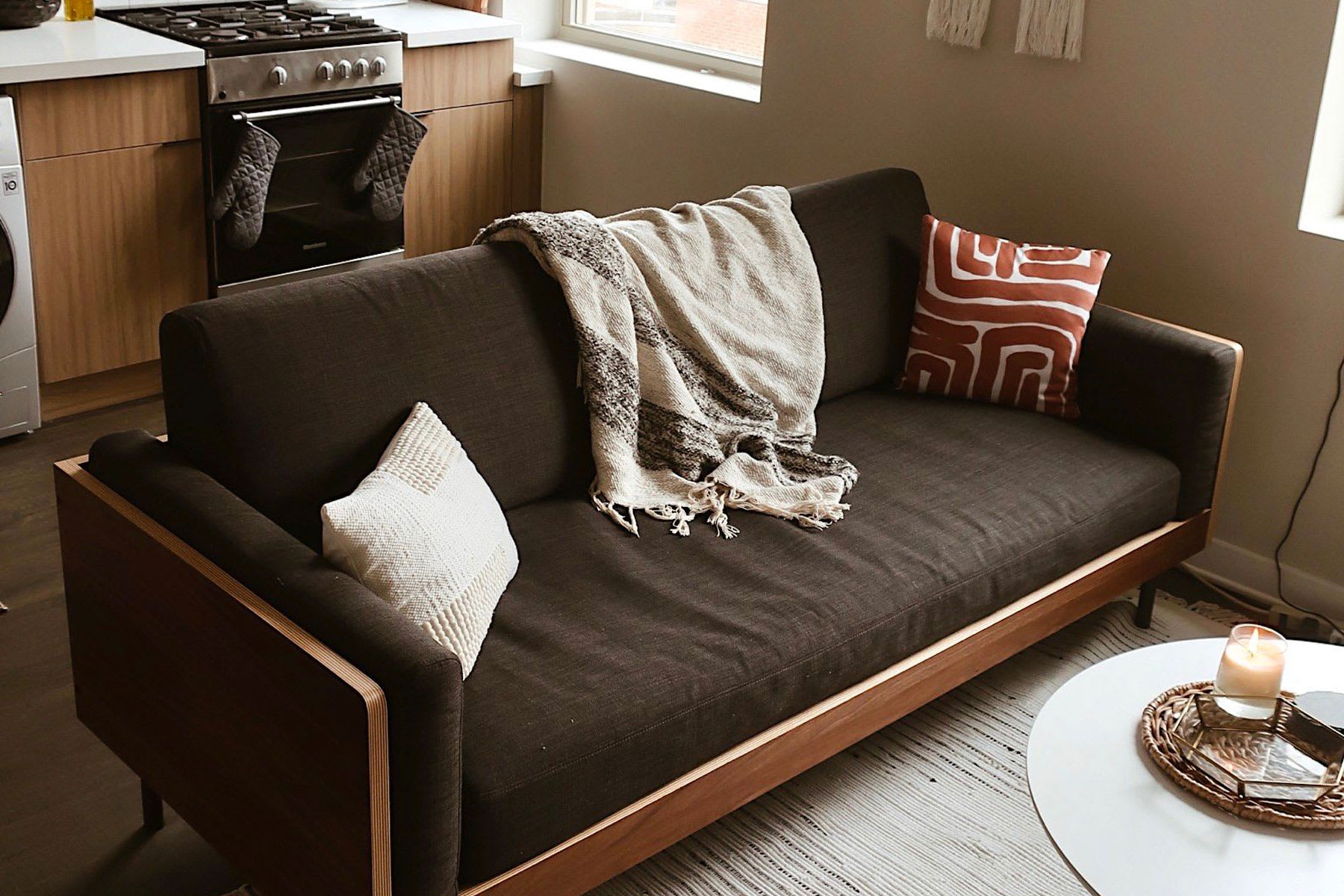 mid century modern sofa in apartment with coffee table