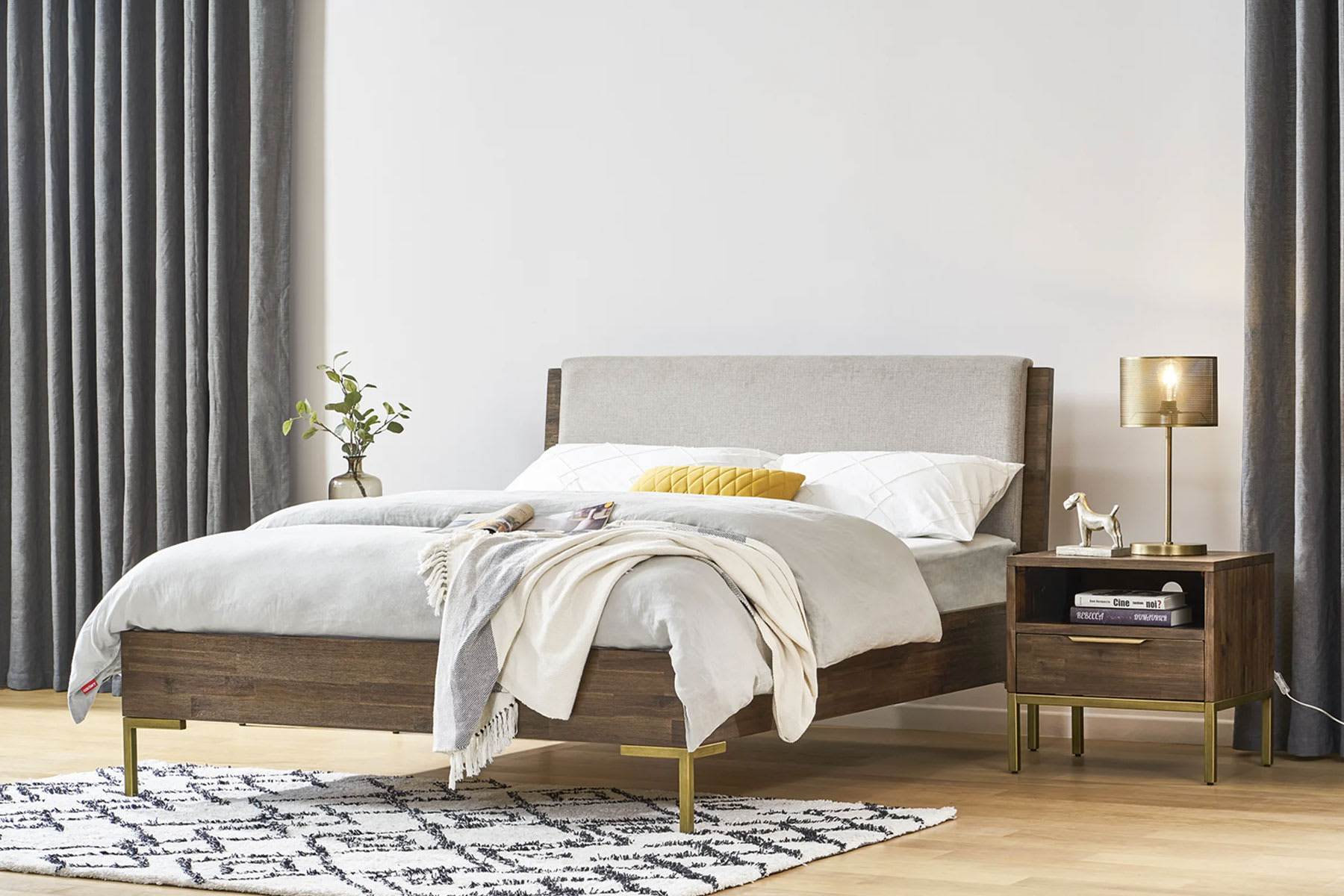 mid-century modern bedroom  with bed and side tables