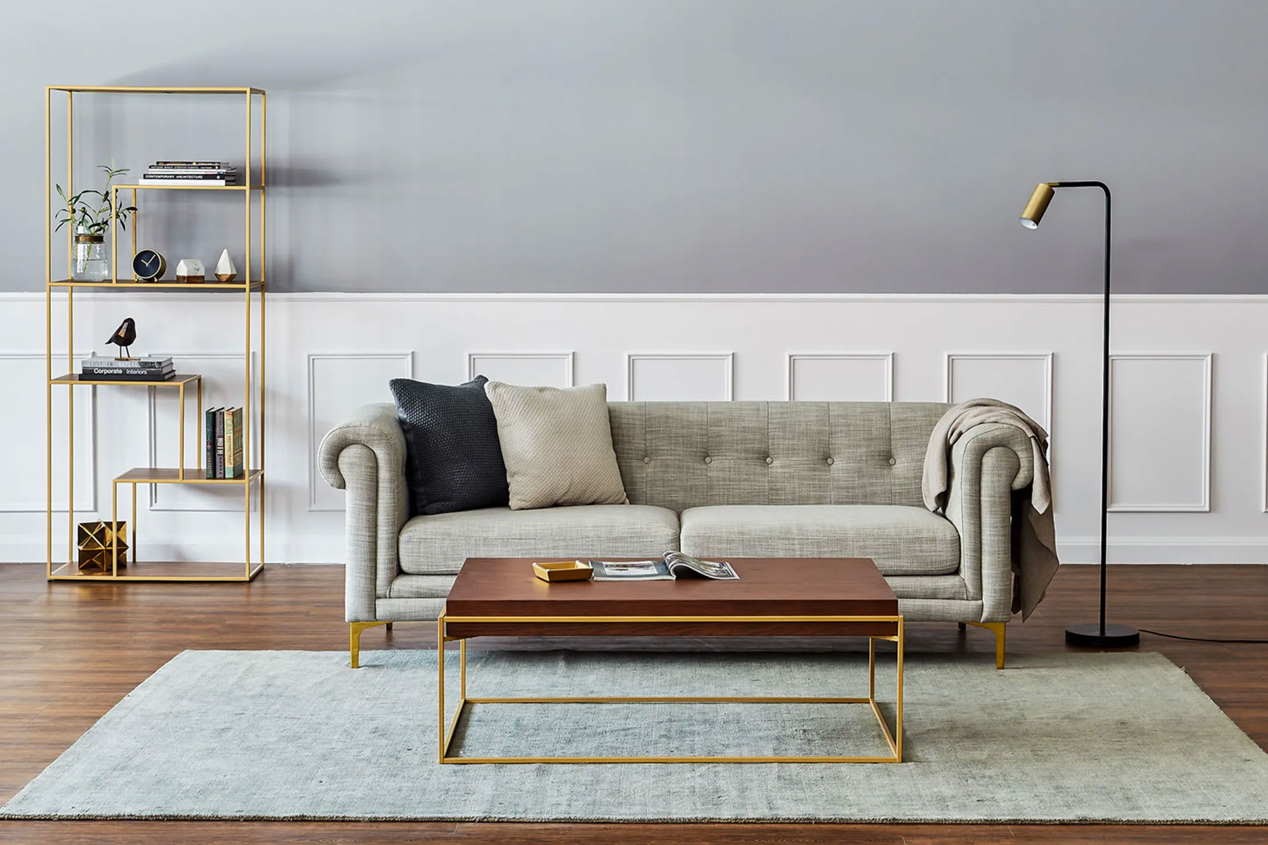 mid-century modern living room with sofa, coffee table and shelf