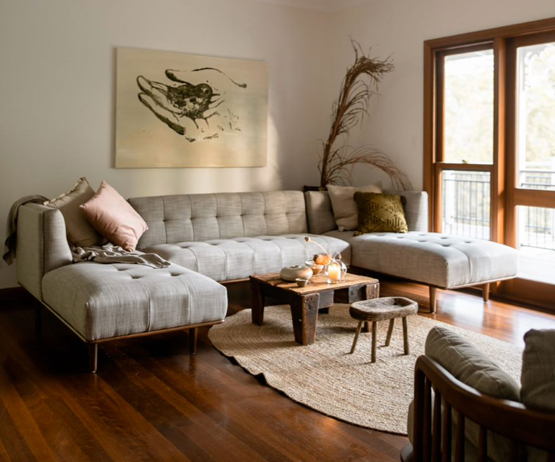 mid-century modern living room with sectional sofa, coffee table and rug