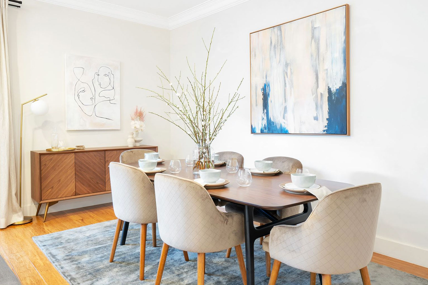 mid-century modern dining room with dining table, chairs, sideboard and lamp