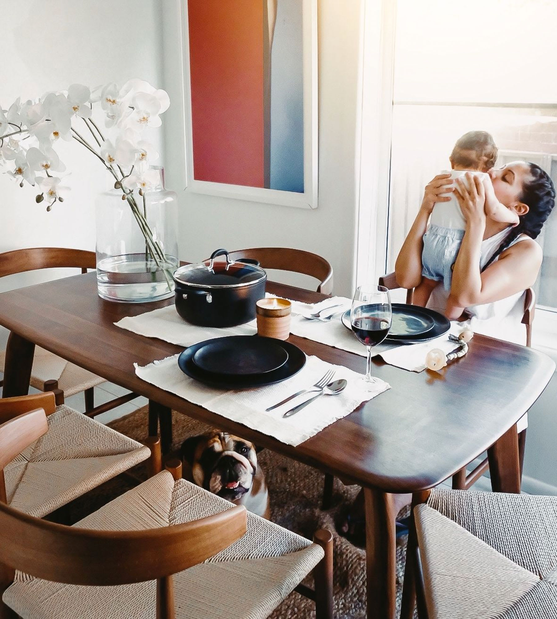 modern dining table, chairs and tableware in living room