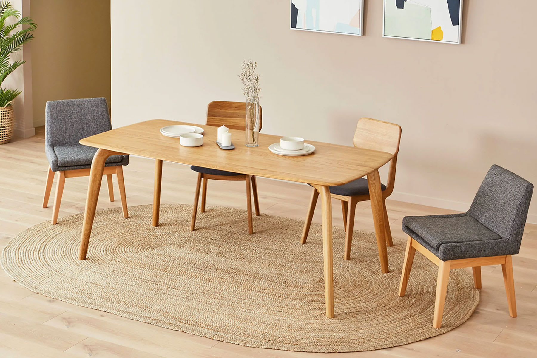 Bright Scandi dining space with wood dining table and chairs