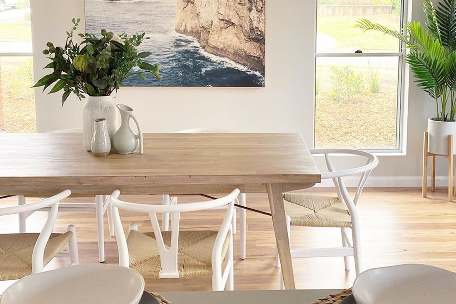 Bright coastal home with dining table and chairs