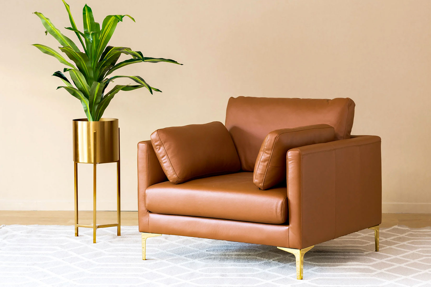 armchair in living room with plant decor