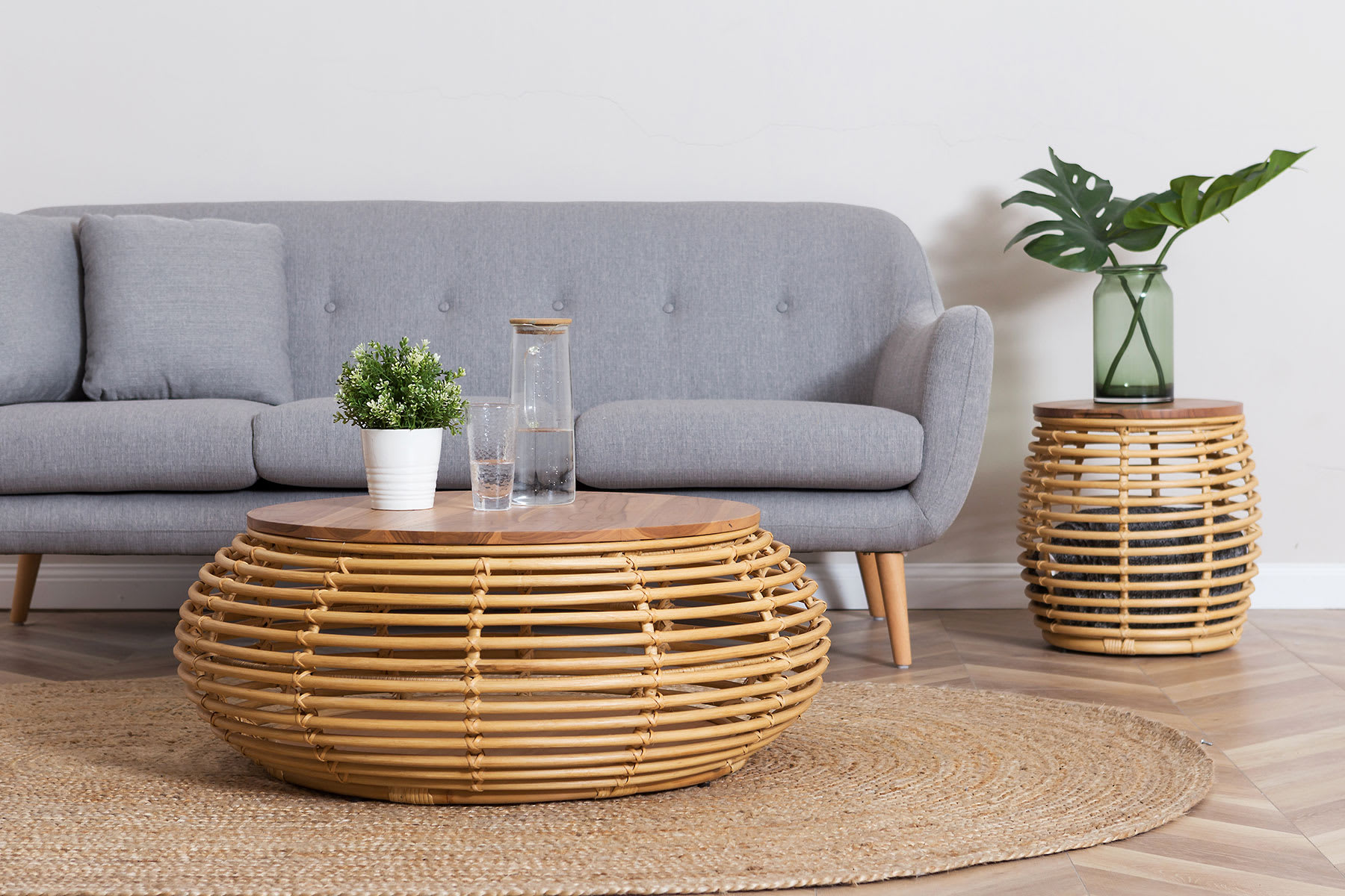 boho tropical chic living room furniture with scandinavian sofa, rattan and teak coffee table and jute rug
