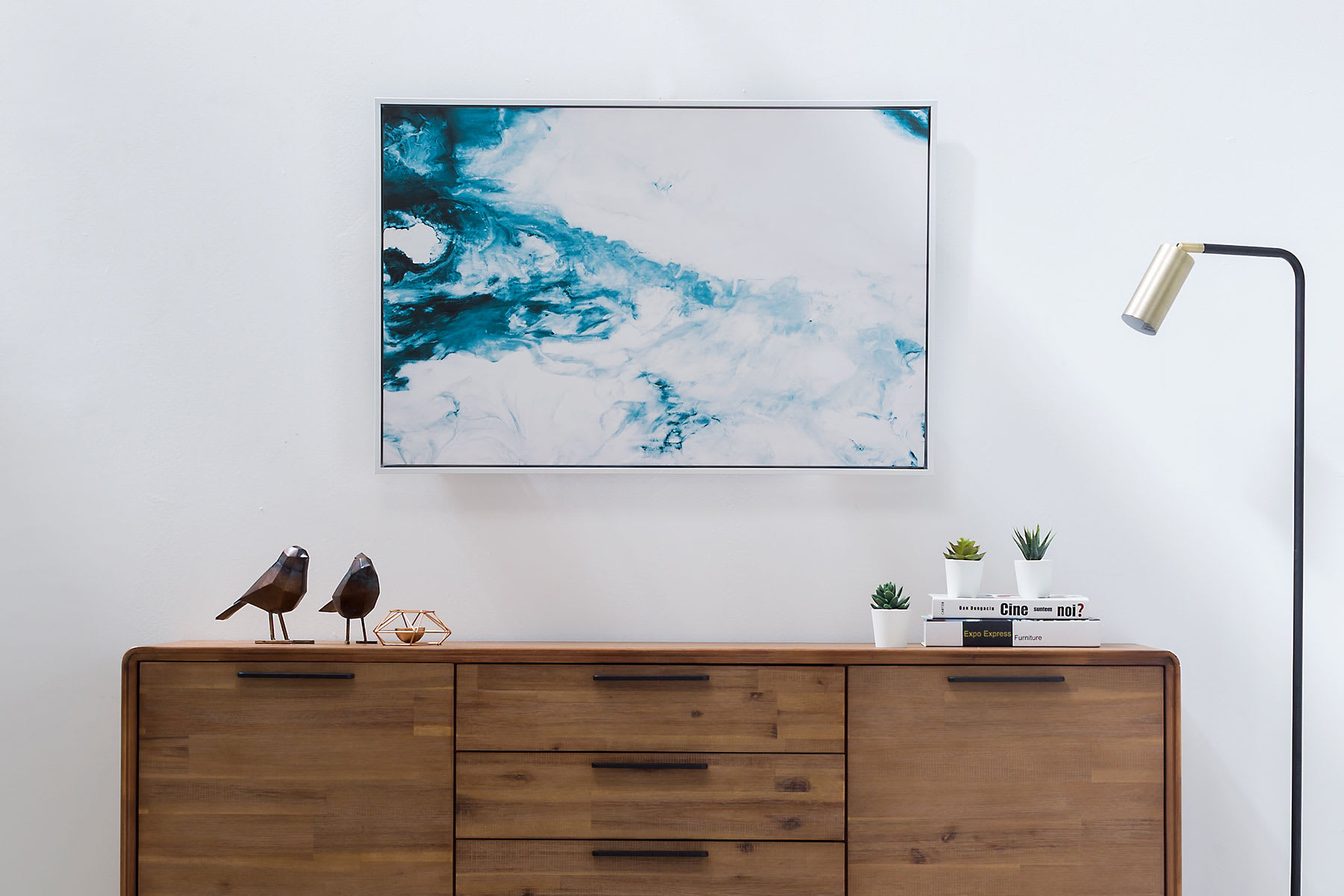 contemporary abstract wall art with wooden sideboard and storage