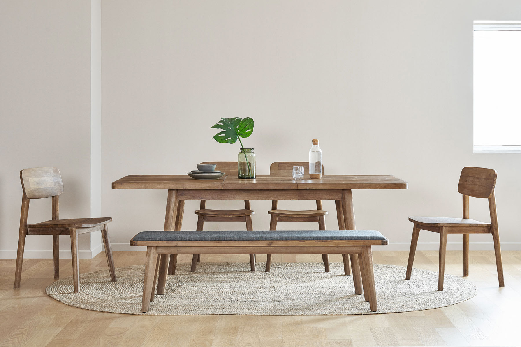 Rectangular dining table, bench and chairs in dining room