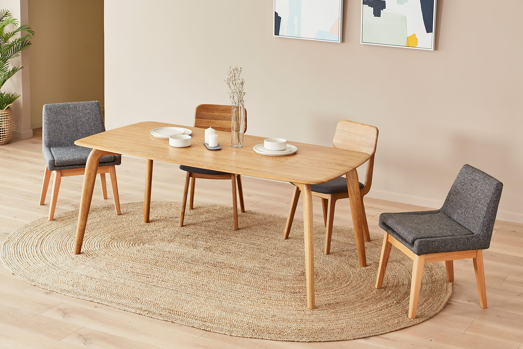 Curved rectangular dining table with chairs and plants in dining room