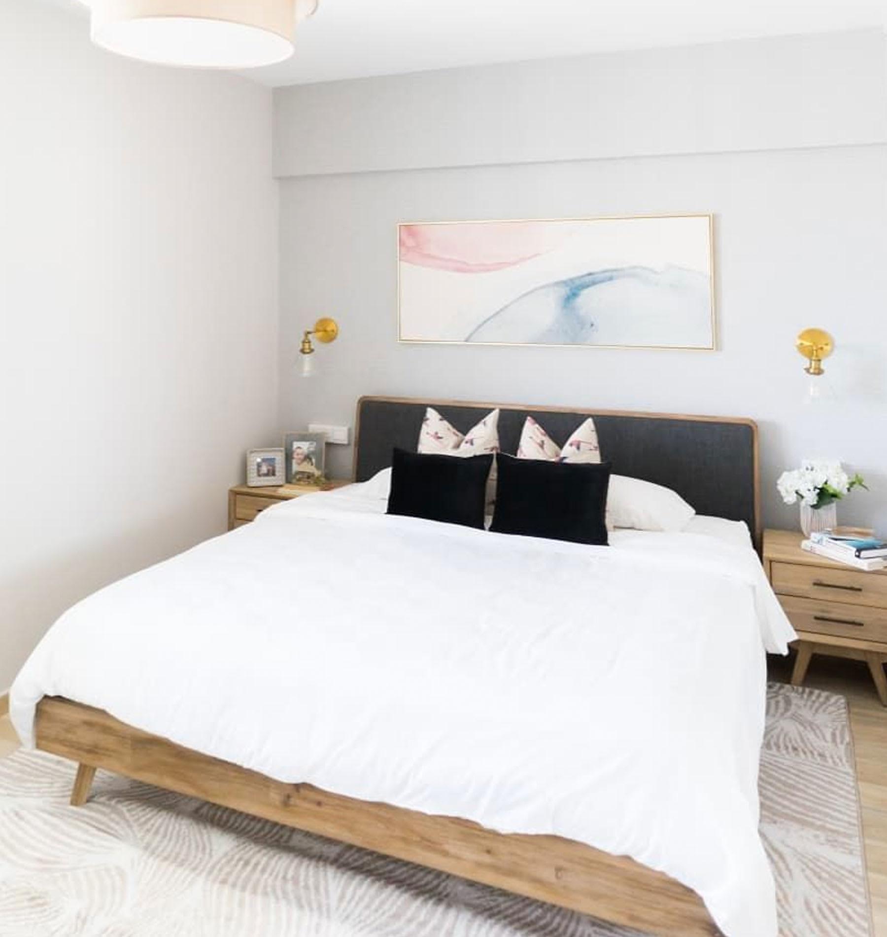 dark gray fabric queen size bed in bedroom