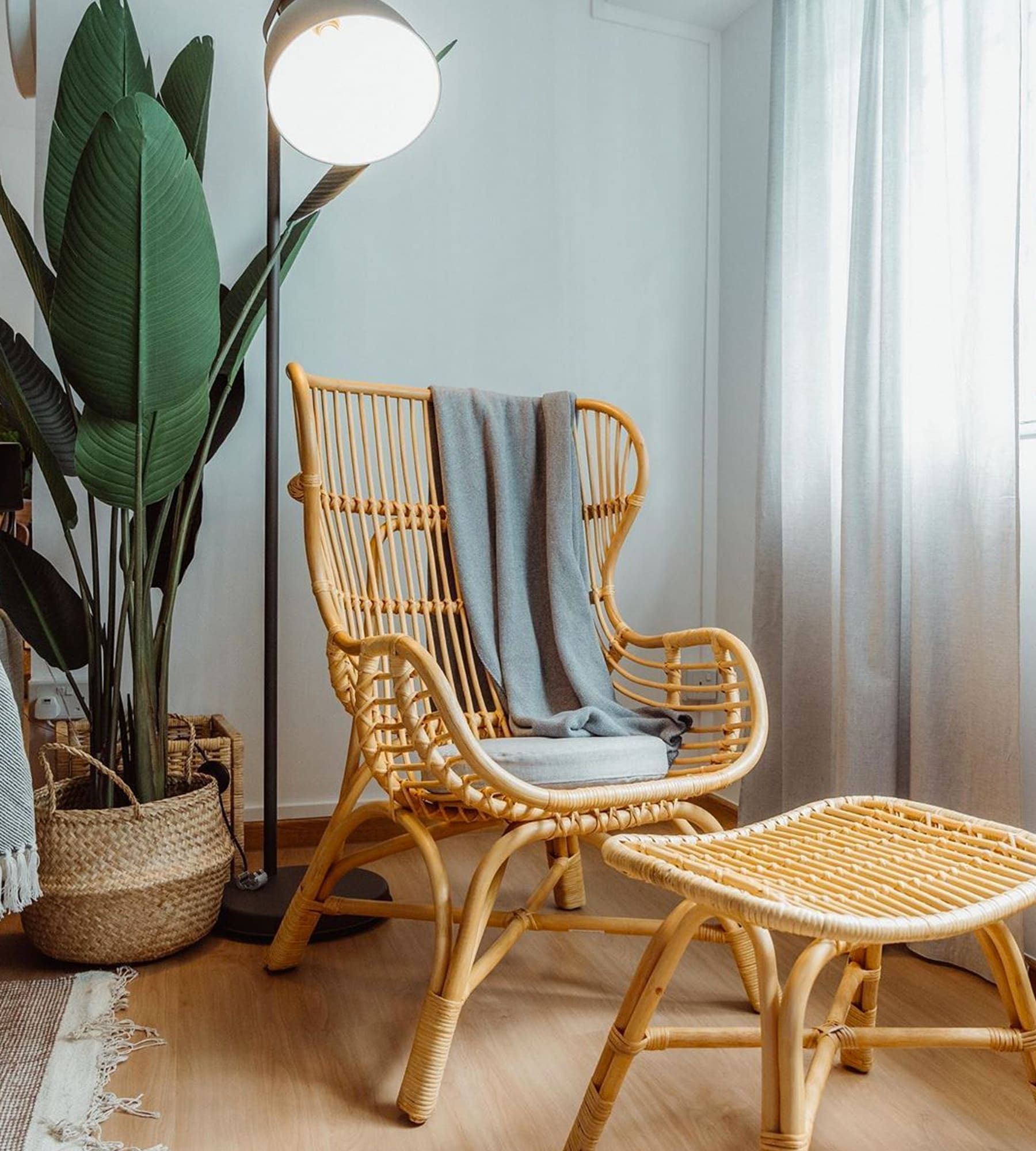 rattan armchair and stool in resort-style home