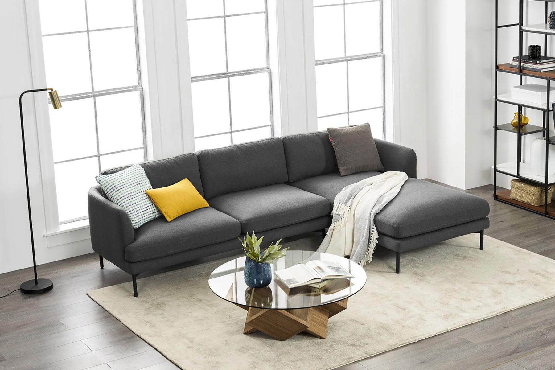 living room with modular sofa, coffee table, rug and standing lamp