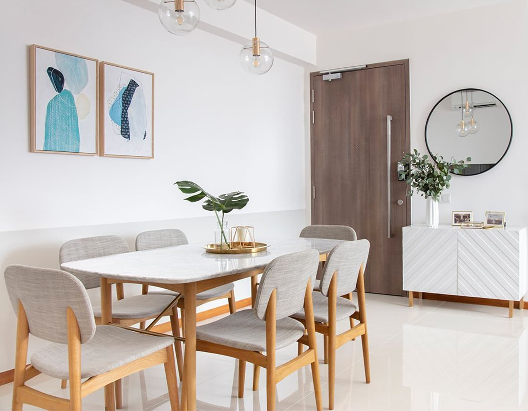 marble dining table with wooden dining chairs in mid-century modern space with console