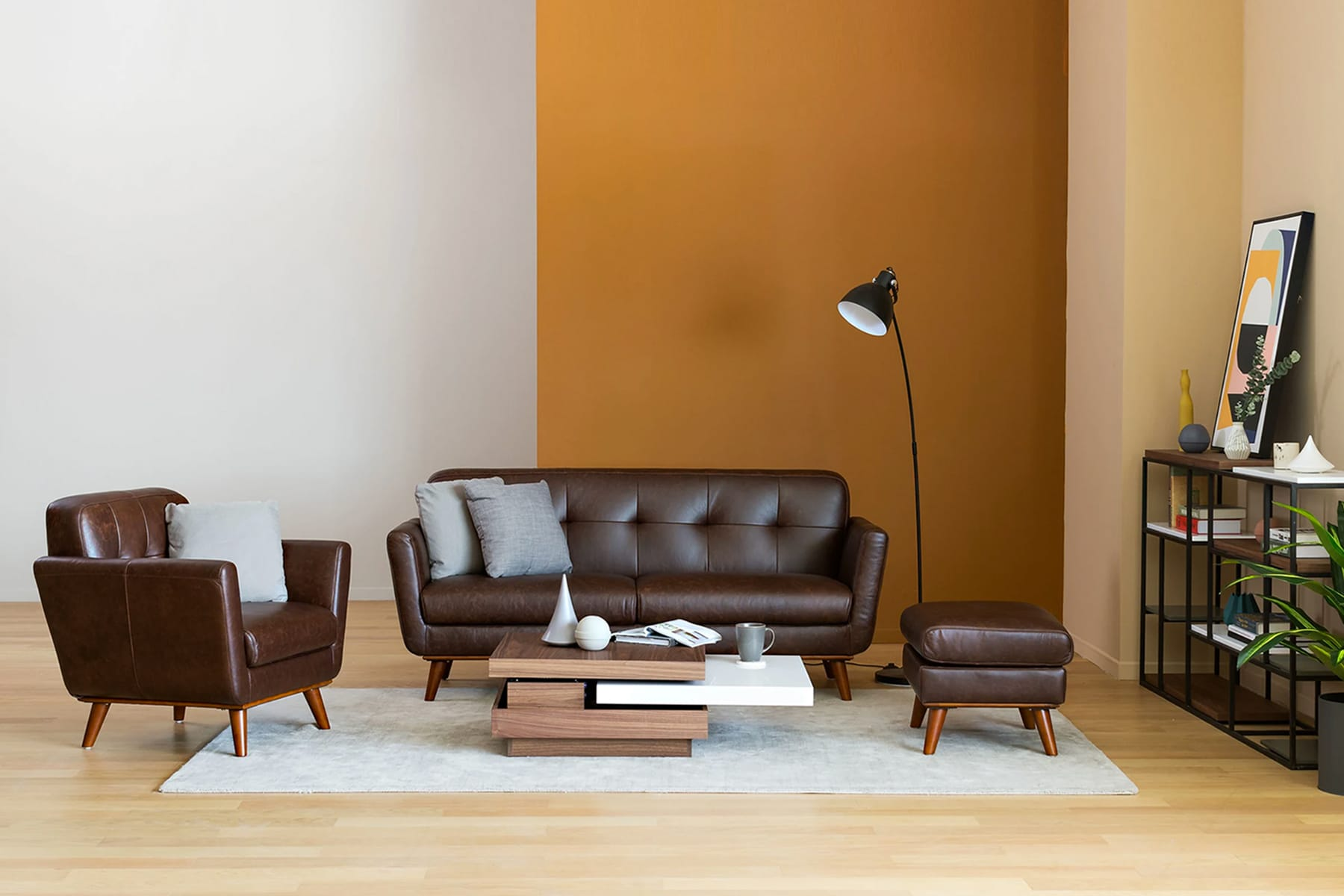 brown learther sofa, armchair and ottoman in a contemporary living room
