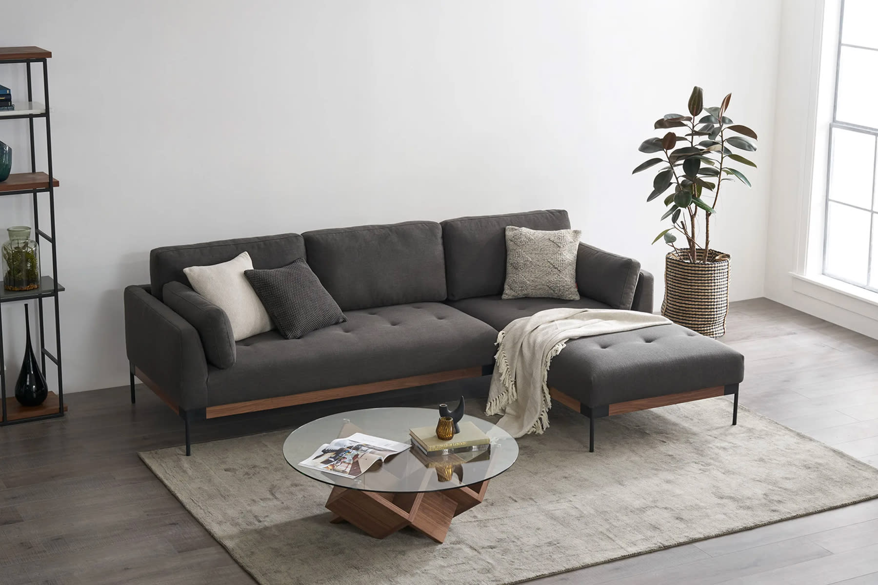 sectional sofa, coffee table and potted plant in a bright living room