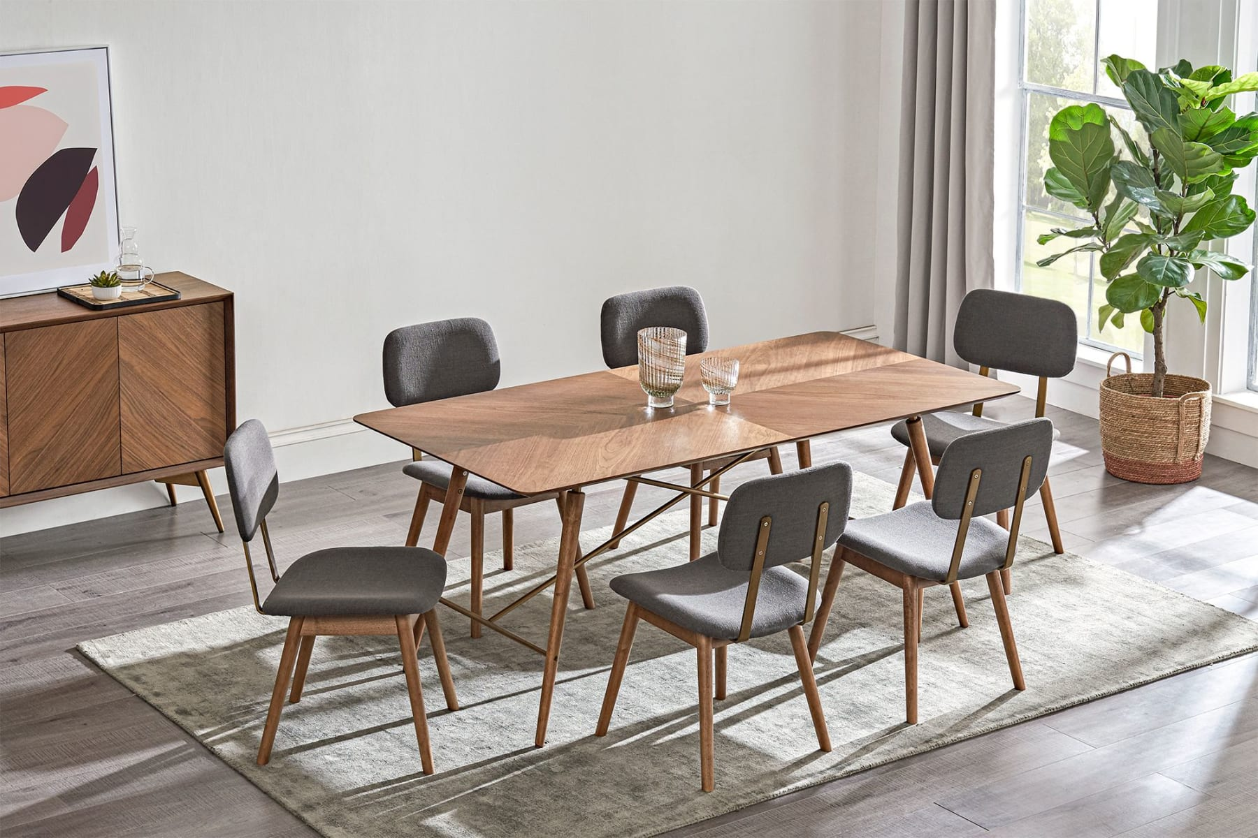 Dining table, chairs and sideboard with contemporary art in dining room