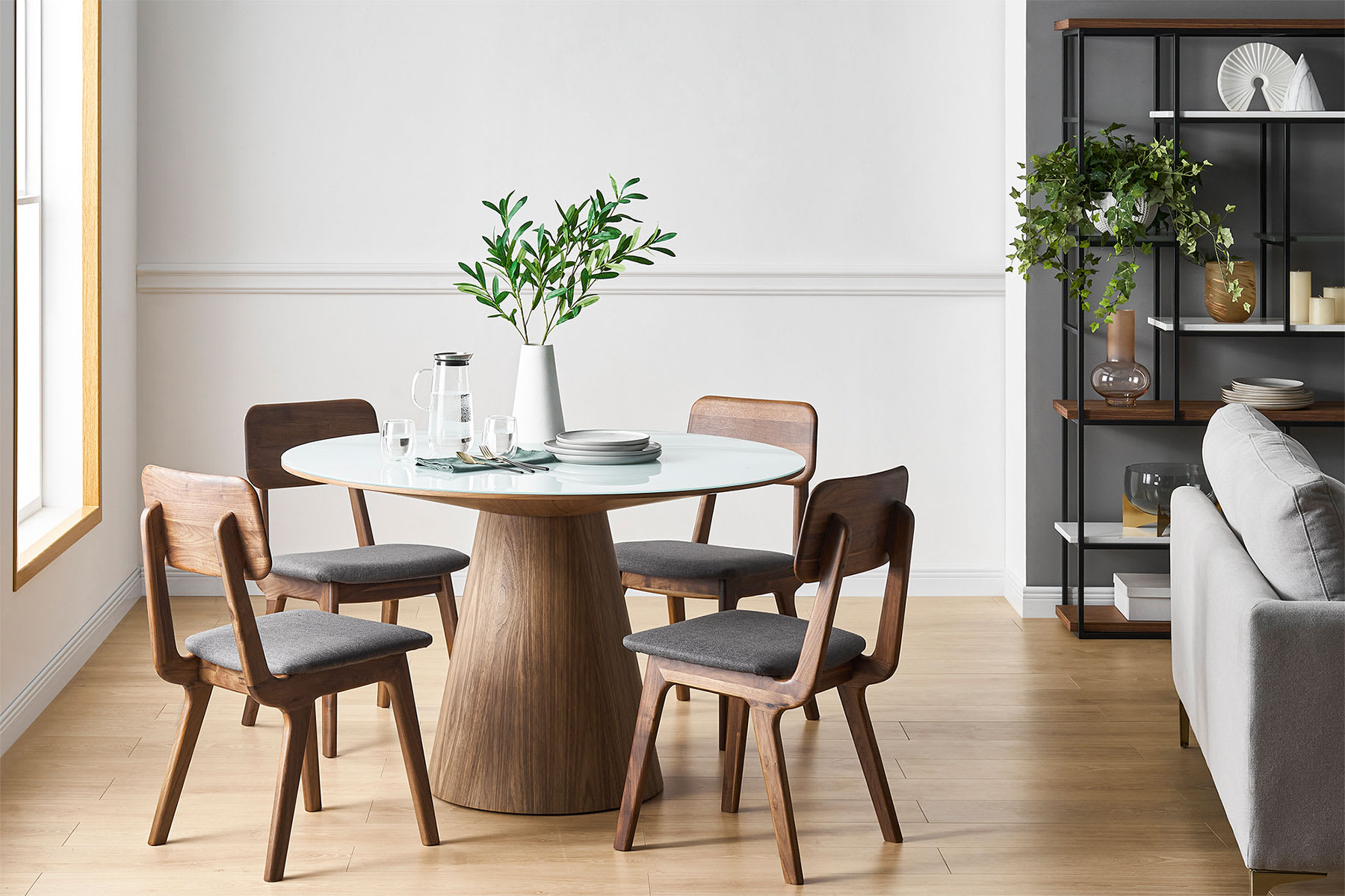 Round dining table, chairs and plant