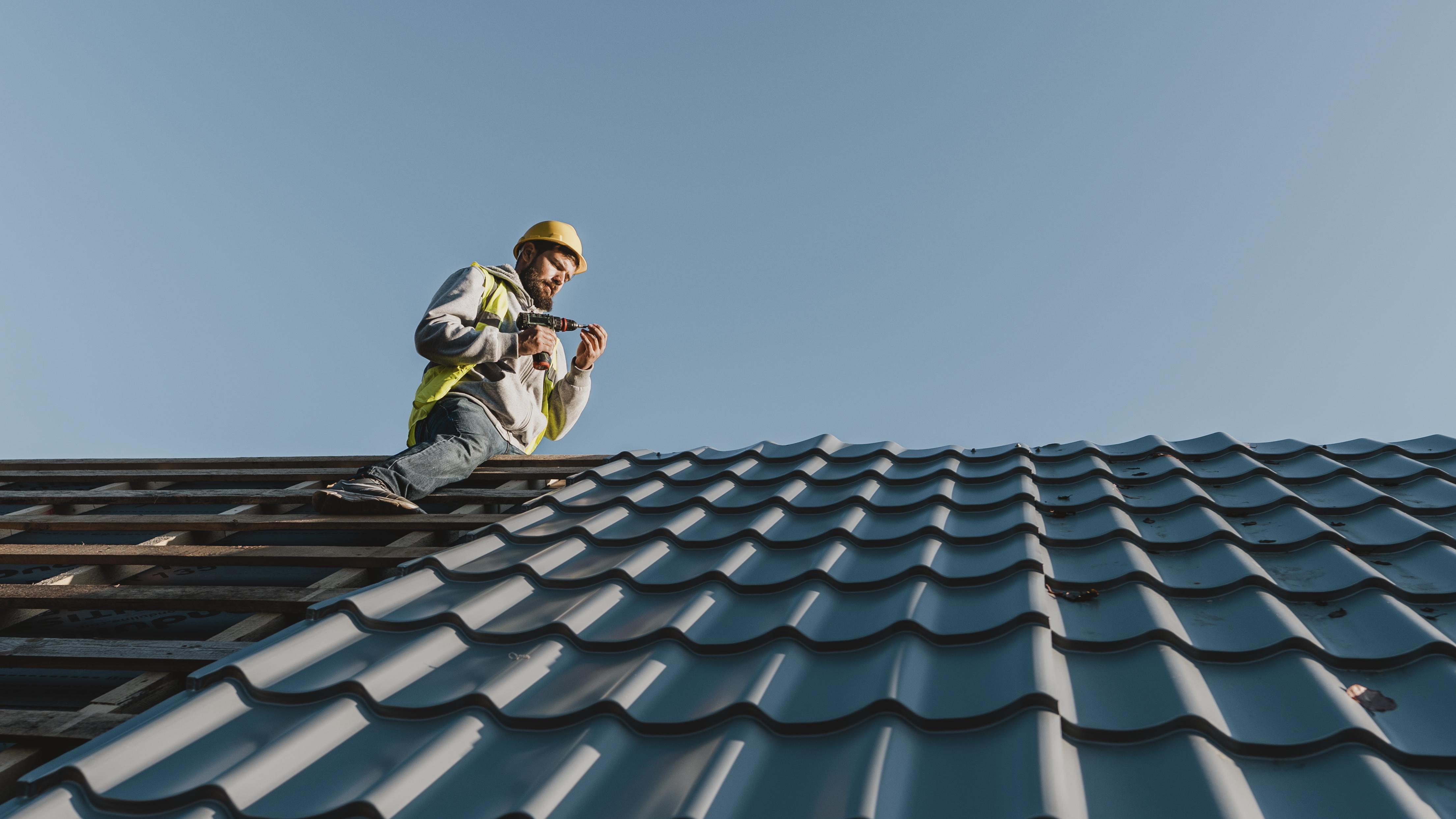 Worker getting ready to install solar panels - solar installation company business loan