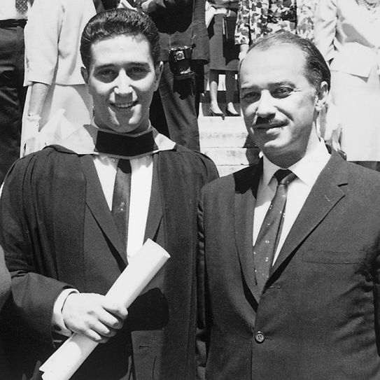 Meyer Feldberg holding his diploma as a young man with his father