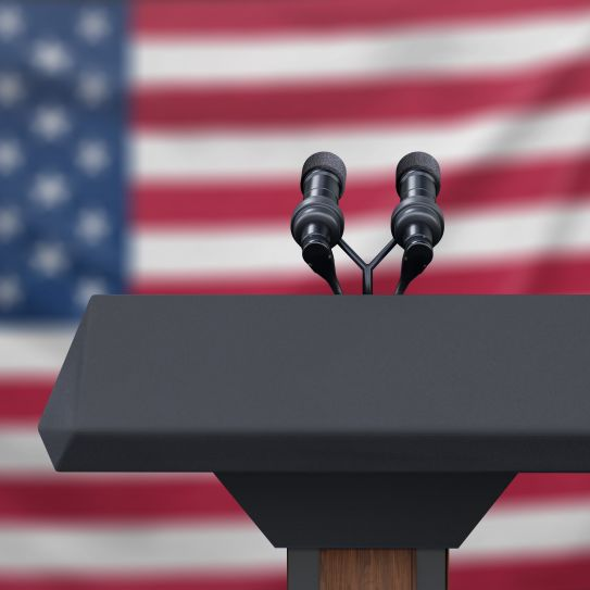 microphone on podium in front of American flag